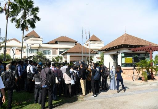 Reporters crowd outside a building where new Prime Minister Mahathir Mohamad was starting his first day in office at Perdana Leadership Foudation in Putrajaya
