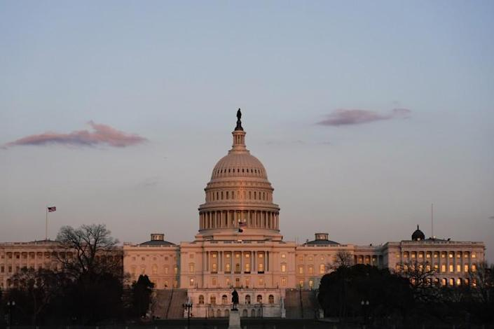 The sun sets on the U.S. Capitol building, Thursday, March 4, 2021, in Washington.