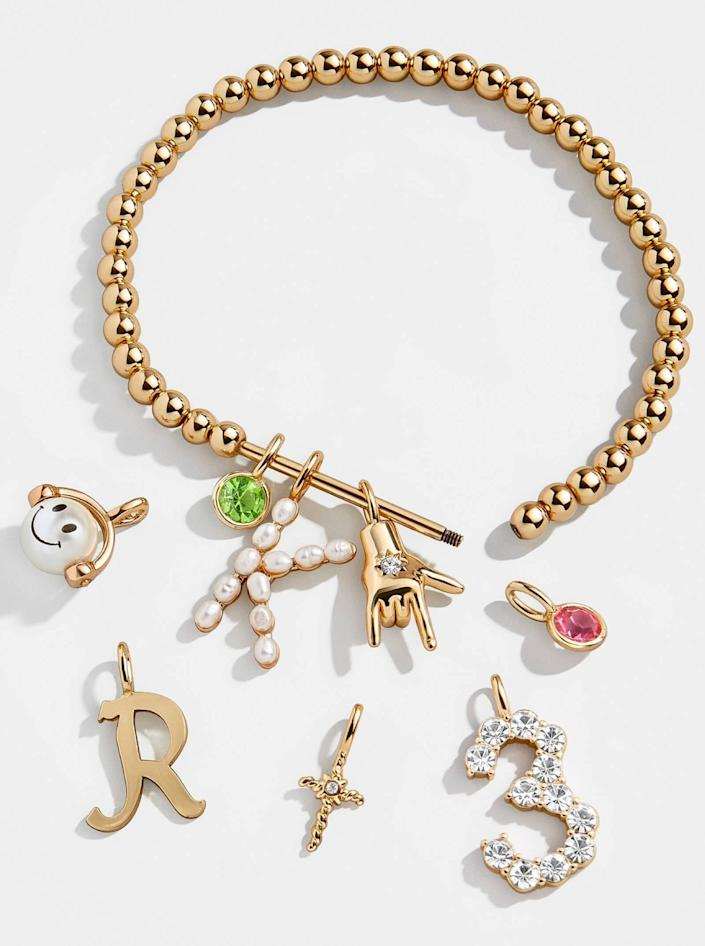 """Personalize this charm bracelet with initials, birthstones, and other cute charms for a sentimental token of congratulations. $30, Baublebar. <a href=""""https://www.baublebar.com/product/52350-the-bauble-bar-bracelet?sku=50936"""" rel=""""nofollow noopener"""" target=""""_blank"""" data-ylk=""""slk:Get it now!"""" class=""""link rapid-noclick-resp"""">Get it now!</a>"""