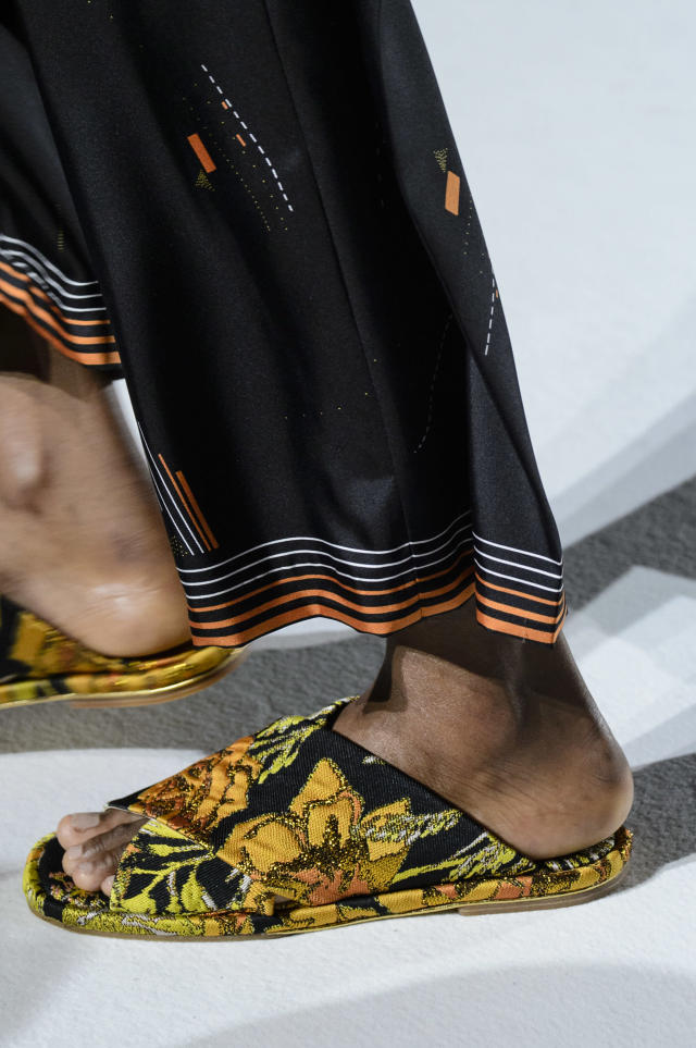 <p><i>Orange floral embroidered sandals from the SS18 Dries Van Noten collection. (Photo: ImaxTree) </i></p>