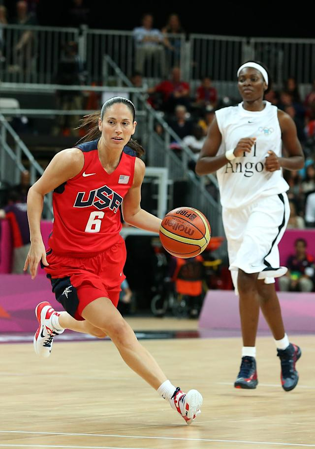 LONDON, ENGLAND - JULY 30: Sue Bird #6 of United States drives the ball past Luisa Tomas #11 of Angola during the Women's Basketball Preliminary Round match on Day 3 at Basketball Arena on July 30, 2012 in London, England. (Photo by Christian Petersen/Getty Images)