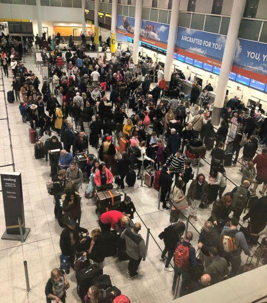 PHOTO: Queues of passengers wait at the check-in desks at Gatwick Airport, as the airport remains closed with flights delayed or diverted to other airports, after drones were spotted over the airfield last night and this morning Thursday Dec. 20, 2018. (AP)