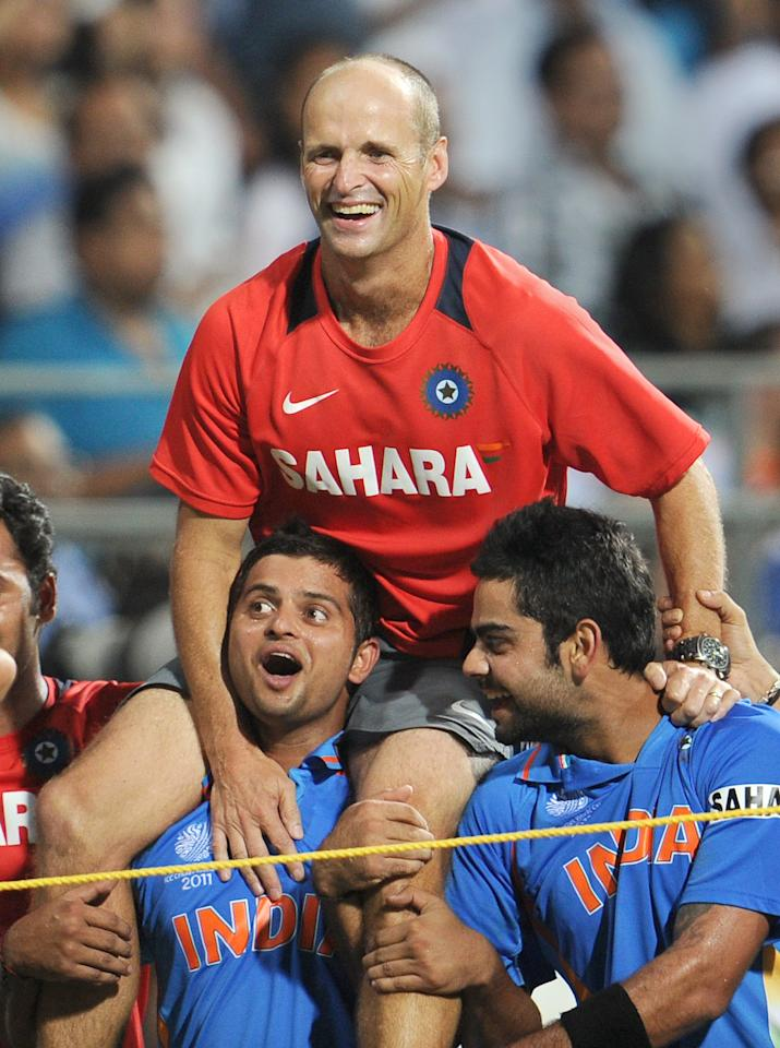 Indian cricket coach Gary Kirsten is carried by players after India defeated Sri Lanka in the ICC Cricket World Cup 2011 final played at The Wankhede Stadium in Mumbai on April 2, 2011.   India beat Sri Lanka by six wickets.  AFP PHOTO/William WEST (Photo credit should read WILLIAM WEST/AFP/Getty Images)
