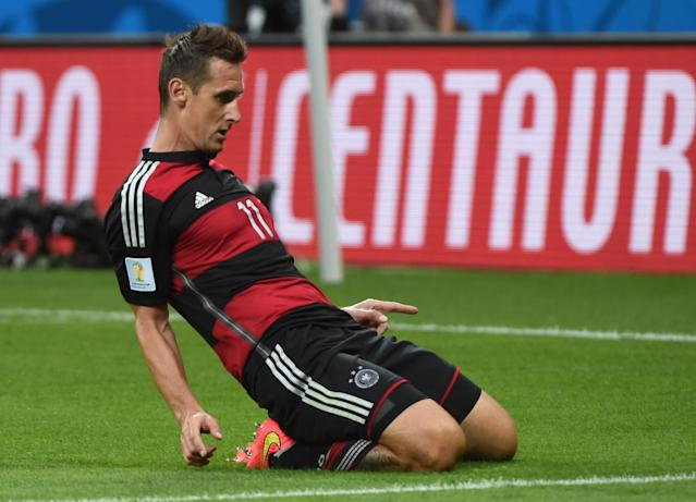 Germany's forward Miroslav Klose celebrates after scoring the second goal during the semi-final football match between Brazil and Germany at The Mineirao Stadium in Belo Horizonte on July 8, 2014 (AFP Photo/Pedro Ugarte)