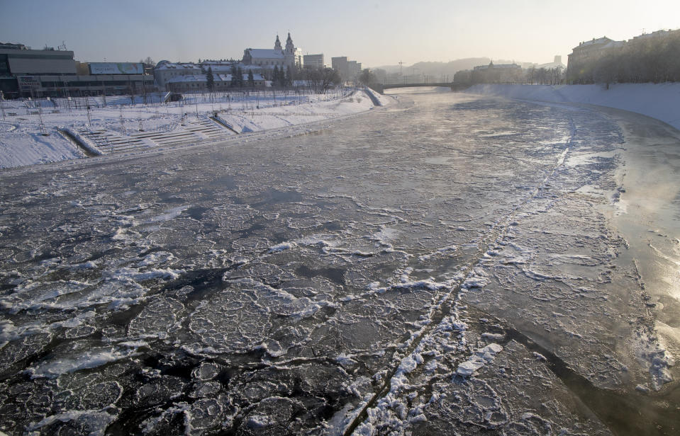 The snow covered Neris River as temperatures dipped to -21 degrees Celsius (-5.8 degrees Fahrenheit) in Vilnius, Sunday, Feb. 7, 2021. (AP Photo/Mindaugas Kulbis)