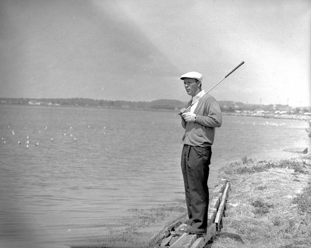 <p>Arnold Palmer is pictured standing looking out to sea with his putter in his hand (Photo by Bob Thomas/Getty Images) </p>