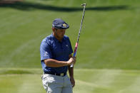 Bryson DeChambeau reacts after missing a putt on the eighth hole during the second round of the The Players Championship golf tournament Friday, March 12, 2021, in Ponte Vedra Beach, Fla. (AP Photo/John Raoux)