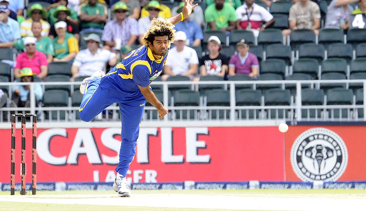 Sri Lanka's bowler Lasith Malinga delivers a ball during the fifth One Day International match (ODI) between South Africa and Sri Lanka at Wanderers Stadium in Johannesburg on January 22, 2012 . AFP PHOTO / STEPHANE DE SAKUTIN (Photo credit should read STEPHANE DE SAKUTIN/AFP/Getty Images)