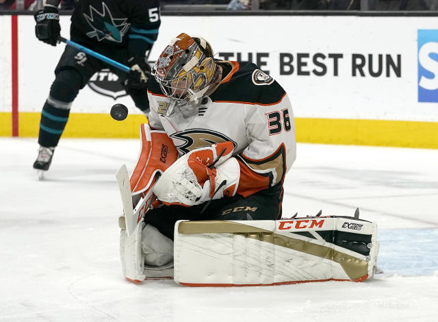 Anaheim Ducks goaltender John Gibson (36) blocks a shot by the San Jose Sharks during the first period of an NHL hockey game in San Jose, Calif., Thursday, Dec. 27, 2018. (AP Photo/Tony Avelar)