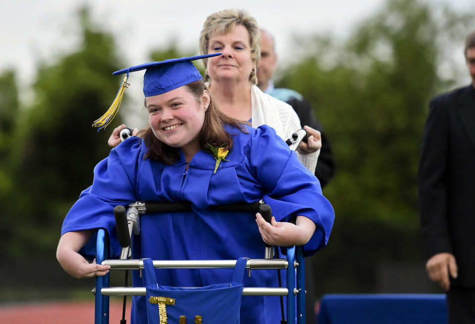 Catie Walsh smiles with her aid, Doris Wagner, a paraprofessional at Tulpehocken High School during commencement ceremony. Walsh, who was diagnosed with cerebral palsy, wanted to leave her wheel chair behind and walk across the field to receive her diploma. Photo by Natalie Kolb 6/7/2017 (Photo By Natalie Kolb/MediaNews Group/Reading Eagle via Getty Images)