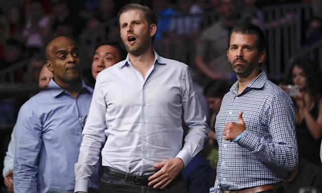 "<span class=""element-image__caption"">Donald Trump Jr and Eric Trump at Colby Covington's fight on Saturday night.</span> <span class=""element-image__credit"">Photograph: Frank Franklin II/AP</span>"