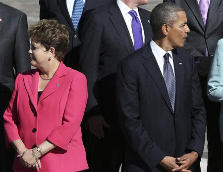 Brazil's President Dilma Rousseff (L) and U.S. President Barack Obama arrive for the family picture event during the G20 summit in St.Petersburg in this September 6, 2013 file photo. REUTERS/Sergei Karpukhin/Files