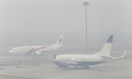 Airplanes are seen at the Kuala Lumpur International Airport in Sepang, on a hazy day outside Kuala Lumpur June 24, 2013.