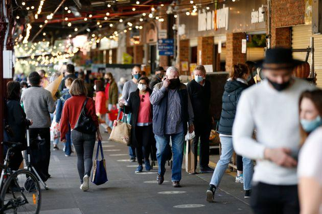 Large crowds of people are seen shopping at South Melbourne Market on August 02, 2020 in Melbourne, Australia.