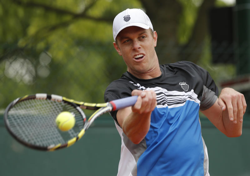 USA's Sam Querrey returns the ball to Slovakia's Lukas Lacko during their first round match of the French Open tennis tournament at the Roland Garros stadium Sunday, May 26, 2013 in Paris. (AP Photo/Christophe Ena)