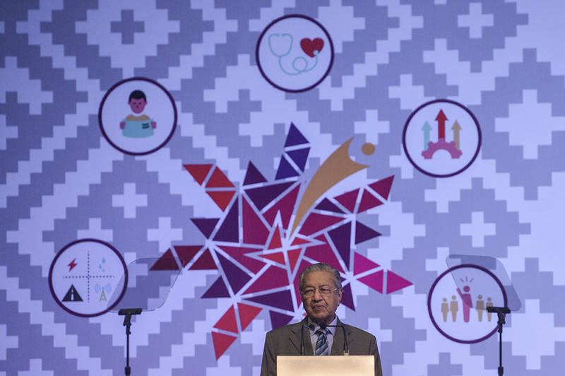 Tun Dr Mahathir Mohamad addresses the Orang Asli National Convention 2019 in Putrajaya April 22, 2019. — Picture by Miera Zulyana