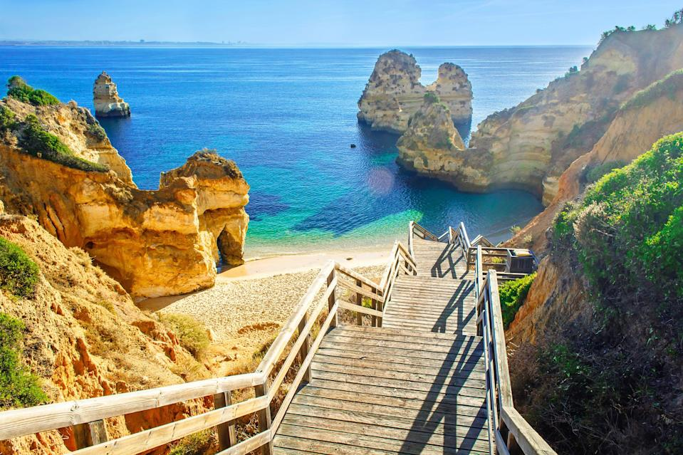 A wooden footbridge leads to the beach at Praia do Camilo in Portugal's Algarve region (Getty Images/iStockphoto)