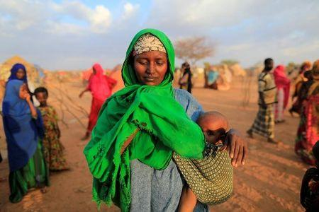 An internally displaced woman from drought hit area reacts after she complains about the lack of food at makeshift settlement area in Dollow, Somalia April 4, 2017. REUTERS/ Zohra Bensemra