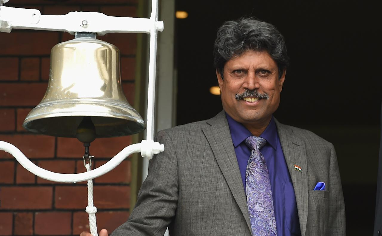 LONDON, ENGLAND - JULY 20:  Former India player Kapil Dev rings the '5 minute bell'  before day four of 2nd Investec Test match between England and India at Lord's Cricket Ground on July 20, 2014 in London, United Kingdom.  (Photo by Stu Forster/Getty Images)