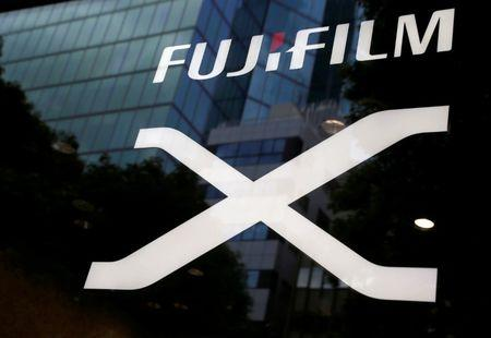 FILE PHOTO: Fujifilm's company logo (top) is seen at its exhibition hall nearby the headquarters of Fujifilm Holdings Corp in Tokyo, Japan June 12, 2017. REUTERS/Kim Kyung-Hoon/File Photo