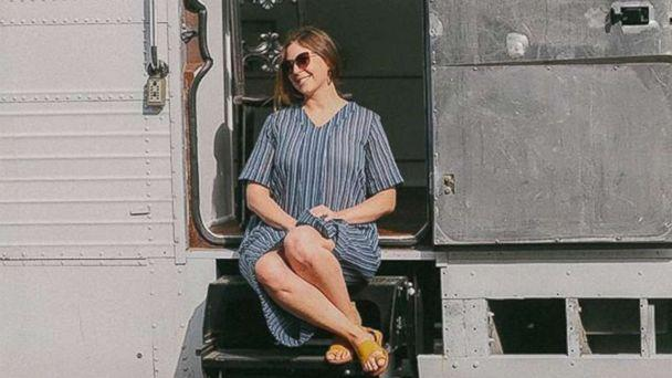 PHOTO: Jessie Lipskin sits on the steps of the chic RV she converted from a Greyhound bus. (Courtesy Jessie Lipskin/@Thebustinyhome)