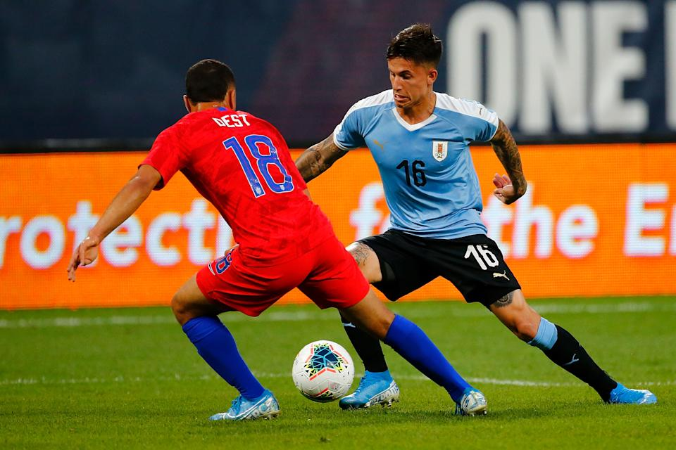 ST LOUIS, MO - SEPTEMBER 10: Brian Rodriguez #16 the Uruguay Men's National Team controls the ball against Sergiño Dest #18 of the United States Mens National Team at Busch Stadium on September 10, 2019 in St Louis, Missouri. (Photo by Dilip Vishwanat/Getty Images)