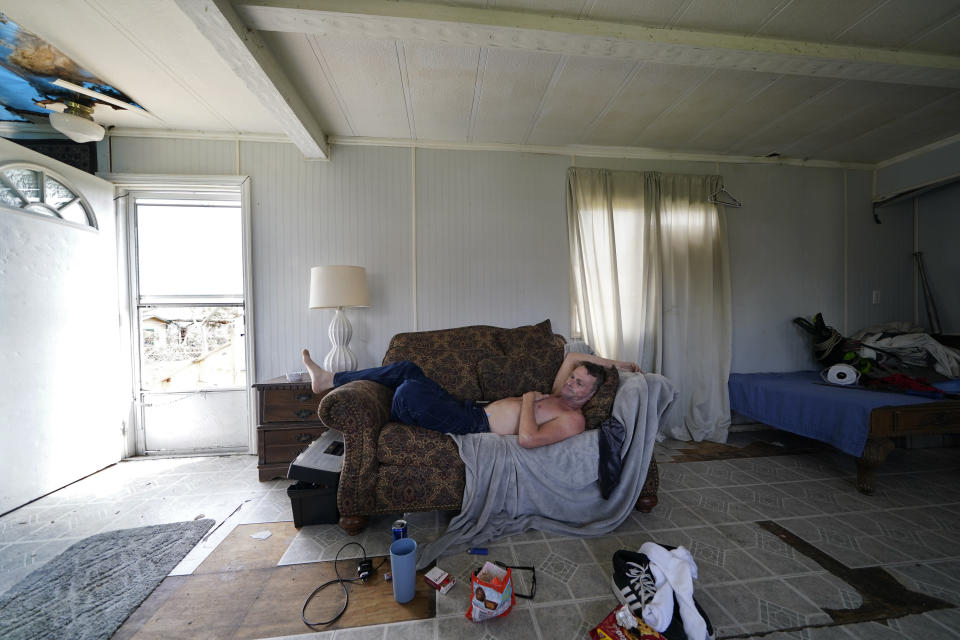 CORRECTS SPELLING OF THE MAN'S NAME - James Townley, who has a heart condition, lies on is couch with no electricity in his partially destroyed mobile home in Lake Charles, La., in the aftermath of Hurricane Laura, Sunday, Aug. 30, 2020. (AP Photo/Gerald Herbert)