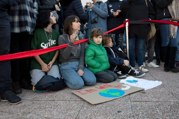 Young supporters of Greta Thunberg await her arrival in Santo Amaro Recreation dock on December 03, 2019 in Lisbon, Portugal. | Evgenia Arbugaeva for TIME