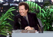 """<p>If you wanted to pick a birthplace for contemporary TV comedy, <i>The Larry Sanders Show </i>is the natural choice. Young writers like Judd Apatow and Steve Levitan, and rising stars like Mary Lynn Rajskub and Janeane Garofalo are among the show's memorable alumni. But the show's Holy Trinity of Shandling, Rip Torn, and Jeffrey Tambor provided its heart, soul, and funnybone. <br></p><p><b><i>Related: <a href=""""https://www.yahoo.com/tv/larry-sanders-show-streaming-120818792545.html"""" data-ylk=""""slk:There's No Flipping Reason Why We Can't Stream 'Larry Sanders';outcm:mb_qualified_link;_E:mb_qualified_link;ct:story;"""" class=""""link rapid-noclick-resp yahoo-link"""">There's No Flipping Reason Why We Can't Stream 'Larry Sanders'</a></i></b></p><p><i>(Credit: Everett Collection)</i></p>"""