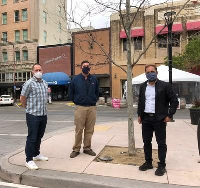 Peter Rumble, CEO of the Santa Rosa Metro Chamber; Adam Jackson, Suburban Propane; and Sonu Chandi, board member of the Downtown Action Organization and local business owner, stand next to a tree originally planted as part of the Courthouse Square reunification program. Suburban Propane's donation will help fund the replacement of dead trees throughout a full block of Santa Rosa's downtown area, set to begin in May. (PRNewsfoto/Suburban Propane Partners, L.P.)