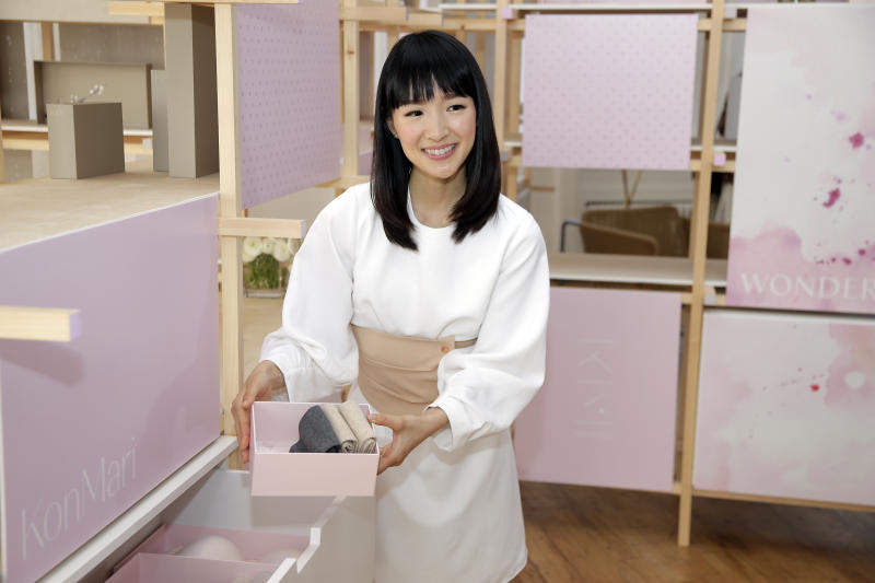 FILE- In this July 11, 2018, file photo, Japanese organizational expert Marie Kondo introduces her new line of storage boxes during a media event in New York. Kondo is sparking joy among shoppers feeling the urge to clean out their homes. But once you master the Japanese organizing expert's novel approach to de-cluttering, what do you do with all the stuff you don't want? (AP Photo/Seth Wenig, File)