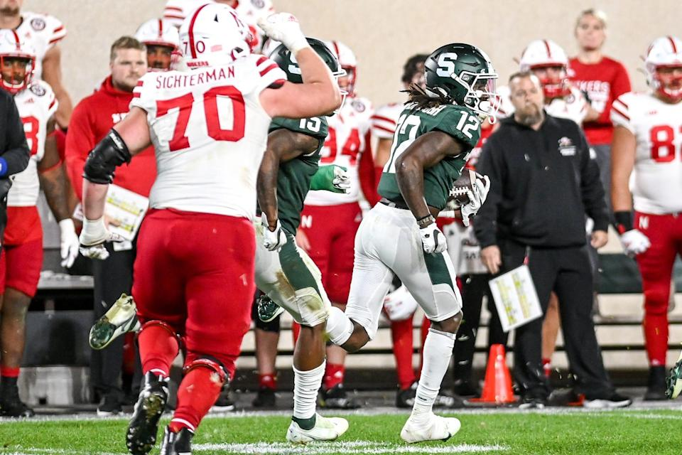 Michigan State's Chester Kimbrough, right, returns an interception against Nebraska during overtime on Saturday, Sept. 25, 2021, at Spartan Stadium in East Lansing.
