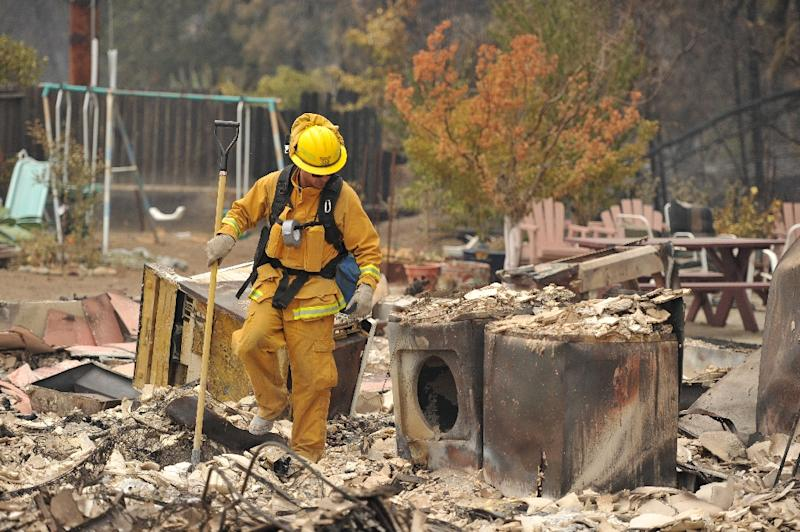 Firefighters search for survivors after the Valley fire tore through a residential area, in Middletown, California on September 14, 2015 (AFP Photo/Josh Edelson)