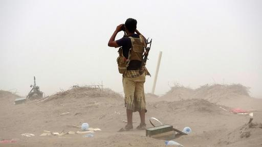 A pro-government Yemeni soldier looks through binoculars on June 7, 2018, near the city of Al Jah in Hodeida province, 50 kilometres (30 miles) from the port city of Hodeida