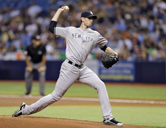 New York Yankees starting pitcher Brandon McCarthy delivers to the Tampa Bay Rays during the first inning of a baseball game Friday, Aug. 15, 2014, in St. Petersburg, Fla. (AP Photo/Chris O'Meara)