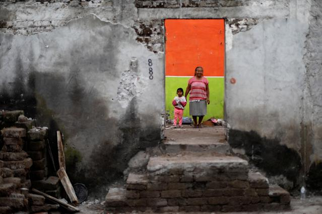 "<p>Elena Zapata, 69, a housewife, poses for a portrait with her granddaughter Mariana, 3, inside the ruins of her house after an earthquake in Tepalcingo, Mexico, September 29, 2017. The house was badly damaged but with the help of her family and soldiers Zapata rescued some furniture. She lives in her backyard and hopes to return when the damage is repaired. ""The most valuable that I have is the life of my granddaughter. We hope the authorities come to visit us. I feel anguish, I hear noises, I just want to cry,"" Zapata said. (Photo: Edgard Garrido/Reuters) </p>"