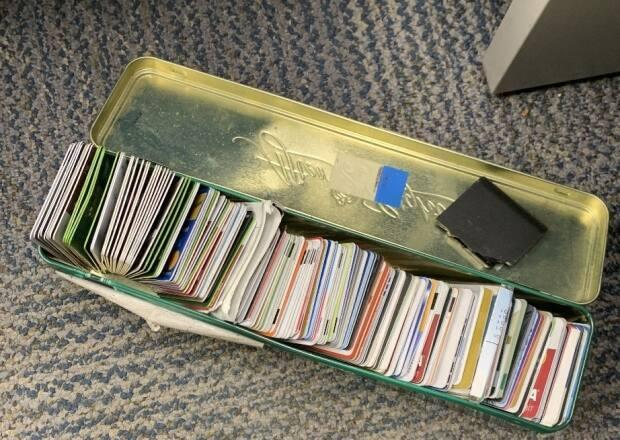 Some of the stolen bank and identity cards seized from a home by Edmonton police.  (Submitted by Edmonton Police Service - image credit)