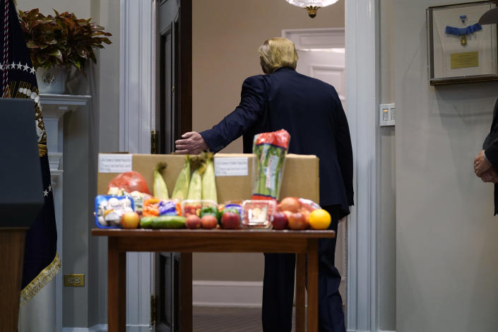 President Donald Trump leaves after an event on the food supply chain during the coronavirus pandemic, in the Roosevelt Room of the White House, Tuesday, May 19, 2020, in Washington. (AP Photo/Evan Vucci)