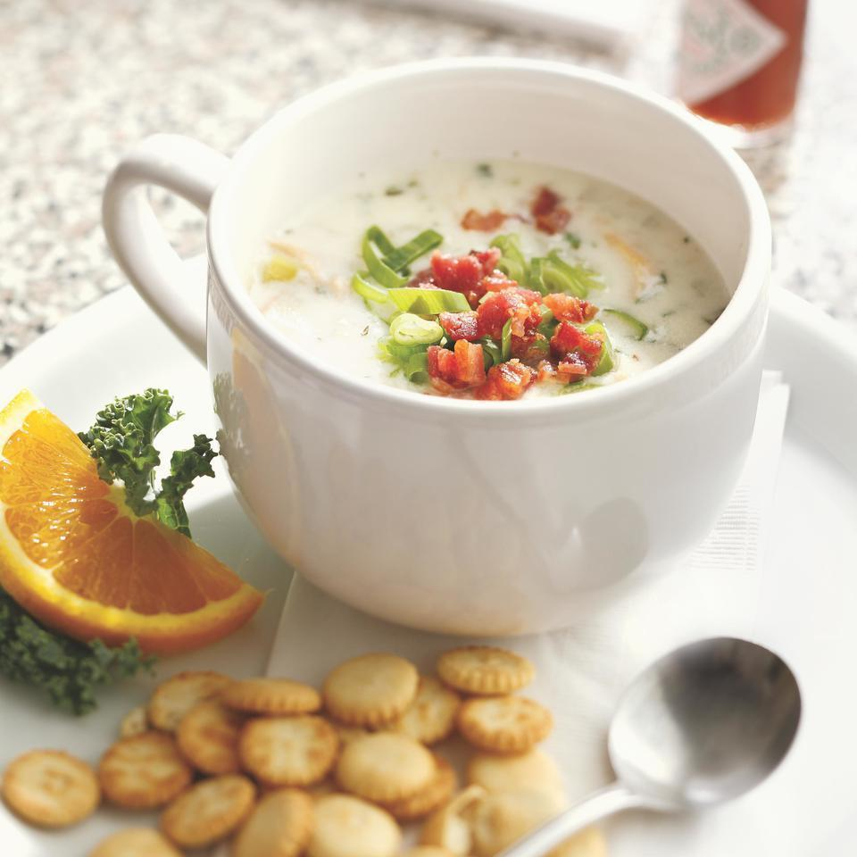 <p>Chopped clams, aromatic vegetables and creamy potatoes blended with low-fat milk and just a half cup of cream gives this chunky New England-style clam chowder plenty of rich body. Serve with oyster crackers and a tossed salad to make it a meal.</p>