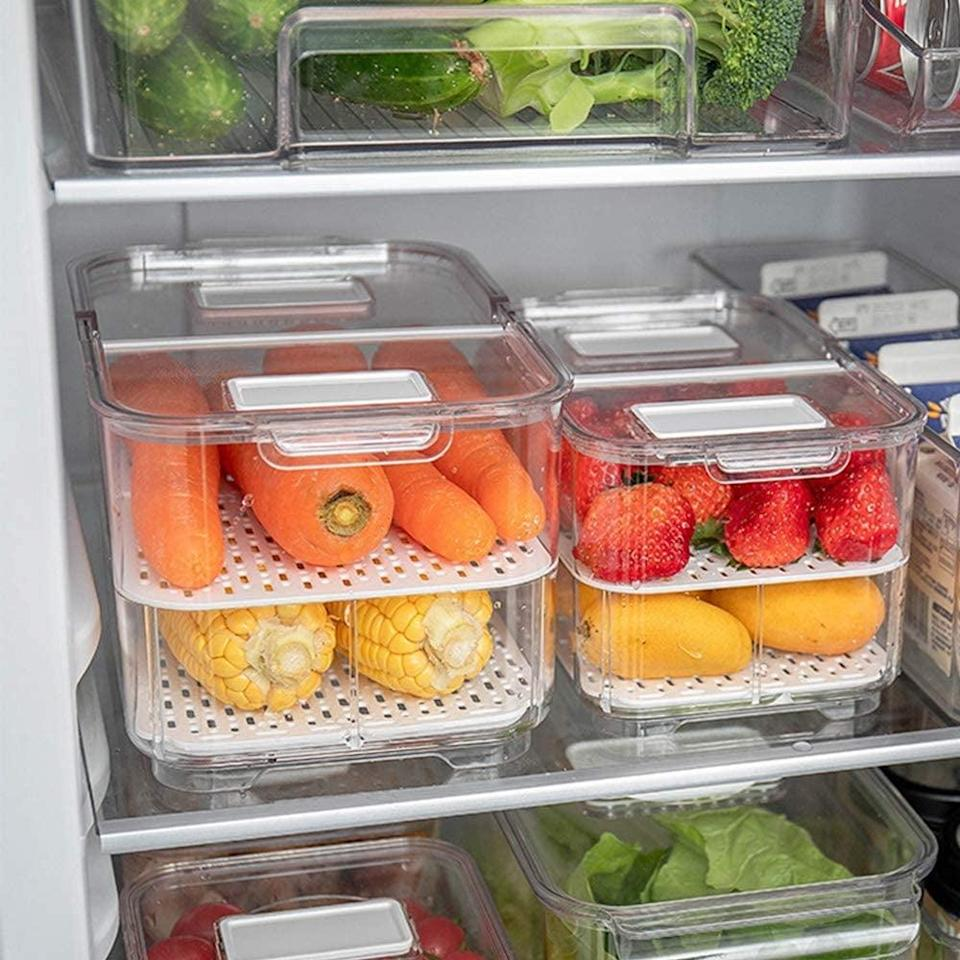 """<p>If you're looking for something with two layers, get this <a href=""""https://www.popsugar.com/buy/elabo-Food-Storage-Containers-Fridge-Produce-Saver-570207?p_name=elabo%20Food%20Storage%20Containers%20Fridge%20Produce%20Saver&retailer=amazon.com&pid=570207&price=36&evar1=yum%3Aus&evar9=46457983&evar98=https%3A%2F%2Fwww.popsugar.com%2Fphoto-gallery%2F46457983%2Fimage%2F47437989%2Felabo-Food-Storage-Containers-Fridge-Produce-Saver&list1=food%20storage%2Ckitchen%20accessories&prop13=api&pdata=1"""" class=""""link rapid-noclick-resp"""" rel=""""nofollow noopener"""" target=""""_blank"""" data-ylk=""""slk:elabo Food Storage Containers Fridge Produce Saver"""">elabo Food Storage Containers Fridge Produce Saver</a> ($36) set.</p>"""