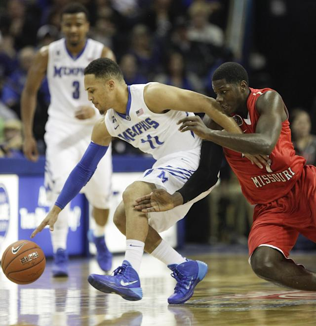 Memphis guard Michael Dixon, Jr. (11) gets to a loose ball ahead of Southeast Missouri forward Nino Johnson (1) in the first half of an NCAA college basketball game on Saturday, Dec. 21, 2013, in Memphis, Tenn. (AP Photo/Lance Murphey)
