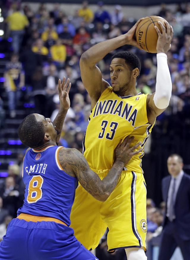 Indiana Pacers forward Danny Granger, right, looks to shoot over New York Knicks guard J.R. Smith during the second half of an NBA basketball game in Indianapolis, Thursday, Jan. 16, 2014. The Pacers defeated the Knicks 117-89. (AP Photo/Michael Conroy)