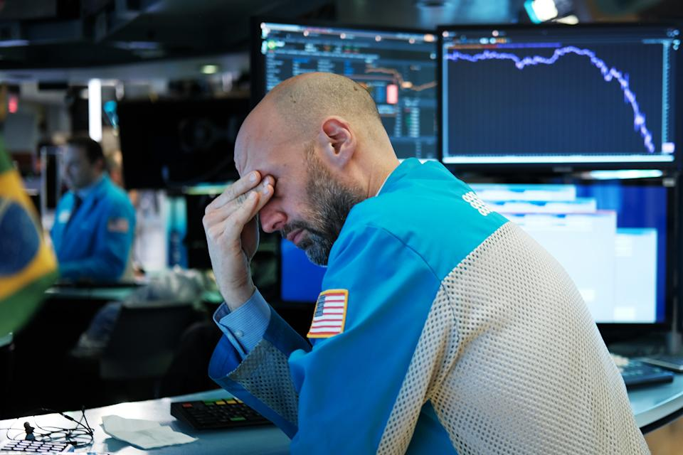 NEW YORK, NEW YORK - MARCH 18: Traders work on the floor of the New York Stock Exchange (NYSE) on March 18, 2020 in New York City. The Dow fell more than 1,200 points today as COVID-19 fears continue to roil world markets. (Photo by Spencer Platt/Getty Images)