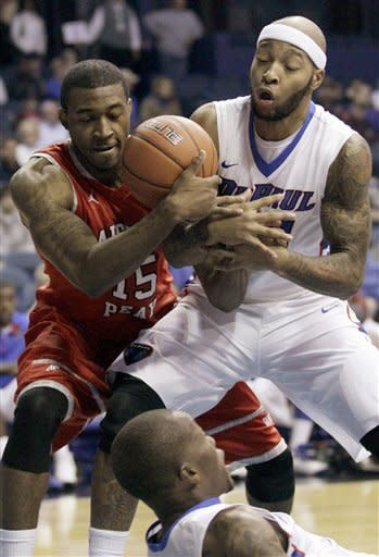 Austin Peay forward Chris Freeman, left, and DePaul forward Montray Clemons battle for a rebound during the first half of an NCAA college basketball game in Rosemont, Ill., on Saturday, Nov. 17, 2012. (AP Photo/Nam Y. Huh)