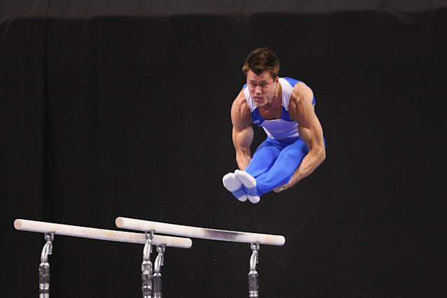 ST. LOUIS, MO - JUNE 7: R.J. Heflin competes in the parallel bars exercise during the Senior Men's competition on day one of the Visa Championships at Chaifetz Arena on June 7, 2012 in St. Louis, Missouri. (Photo by Dilip Vishwanat/Getty Images)