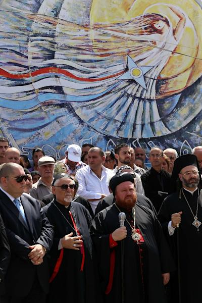 Iraqi Christian clerics and worshipers rally outside the Saint Joseph church in Arbil on August 6, 2015, to mark the first anniversary of an Islamic State group offensive on Christian-populated areas in Nineveh province (AFP Photo/Safin Hamed)