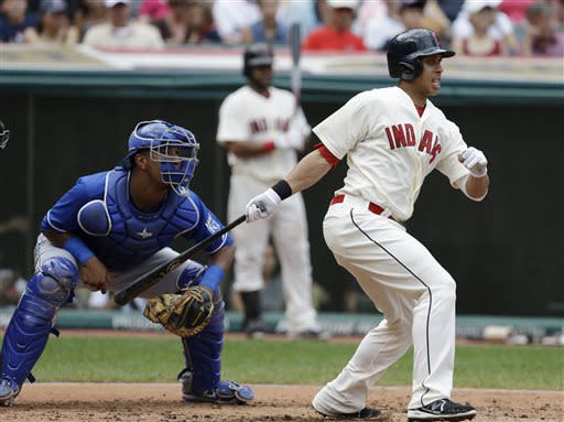 Cleveland Indians' Michael Brantley, right, watches his ball after hitting an RBI-single off Kansas City Royals starting pitcher James Shields in the third inning of a baseball game on Sunday, July 14, 2013, in Cleveland. Royals catcher Salvador Perez, left, also looks on. Indians' Jason Kipnis scored on the play. (AP Photo/Tony Dejak)