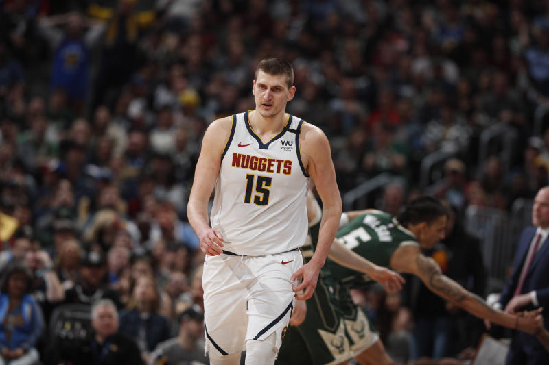 Denver Nuggets center Nikola Jokic (15) in the second half of an NBA basketball game Monday, March 9, 2020, in Denver. The Nuggets won 109-95. (AP Photo/David Zalubowski)