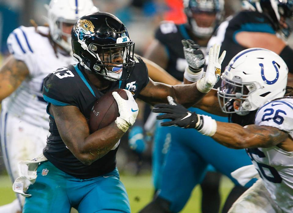 Jacksonville Jaguars running back Ryquell Armstead (23) rushes against Indianapolis Colts safety Clayton Geathers (26) during the second half at TIAA Bank Field.