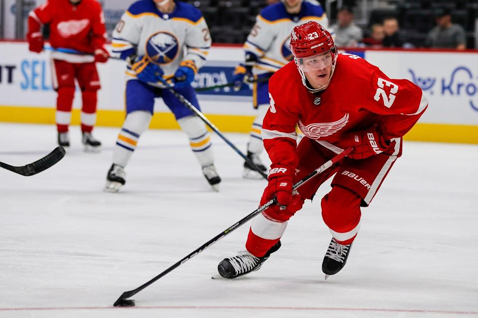 Red Wings left wing Lucas Raymond looks before shooting the puck against the Sabres during the third period of the Wings' 6-2 preseason win at Little Caesars Arena on Thursday, Sept. 30, 2021.